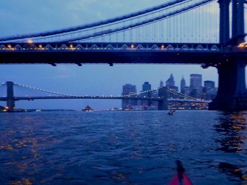 Night falls as we paddle down the East River