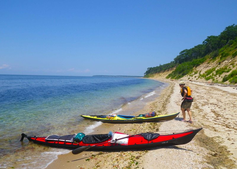 July: We land on the North Shore of Long Island during our kayak circumnavigation of the island
