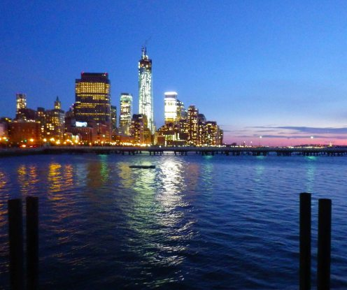 The lights of the new World Trade Center tower shine out brightly in the twilight