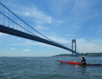 We paddle under the Verrazano-Narrows Bridge...