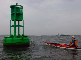 We inspect a new, a very useful, green buoy that the Coast Guard has placed in the harbor
