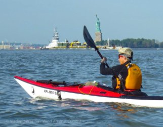 We paddle down the Hudson, with the Statue across the harbor