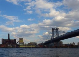 The Domino sugar factory and the Williamsburg Bridge in the late afternoon light