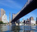 We paddle through the Manhattan-side channel past Roosevelt Island, under the Queensboro Bridge