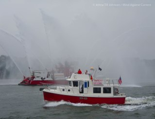 "The fireboat ""Three Forty Three"" welcomes the finishers (photo by Johna)"