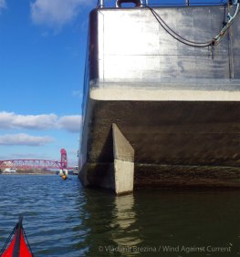 We skirt the barges that are always docked at the power plant