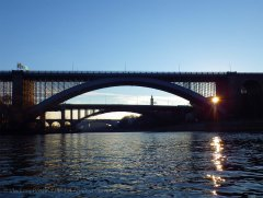 Looking back at the trio of mid-Harlem bridges silhouetted against the declining sun