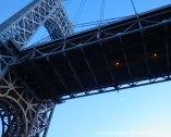 Above the bridge, a crescent quarter moon