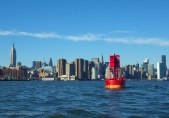 Past the well-known red buoy in the East River