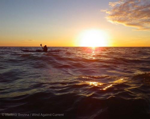 Paddling past the sunset