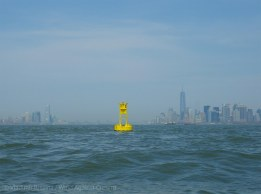 We pass a yellow buoy