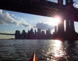 Clouds and sun under the Manhattan Bridge