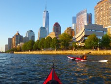 We paddle along the seawall of Battery Park City