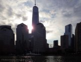The sun peeks out from behind the new World Trade Center tower