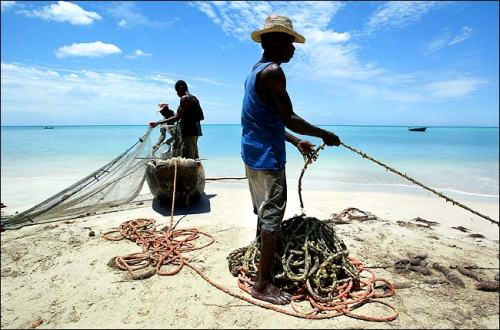 Haitian fishermen (photo Ruth Fremson/The New York Times)