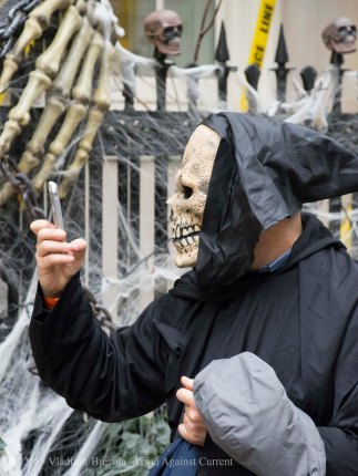 Even skeletons check their cell phones