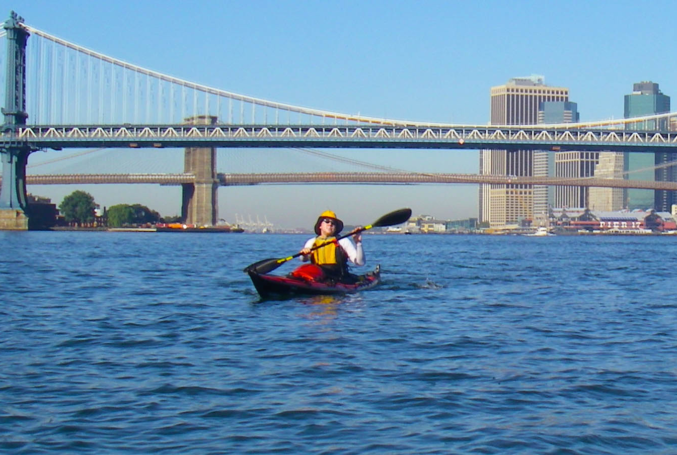 vlad-smiling-with-paddles-and-bridge